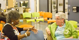 Emma Saunders (left) and Sandra Leigh talk during Tuesday night's election viewing party. Photo by Hannah Leyva.