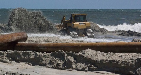 A slurry of water and sand emerges from pipes on Carolina Beach during beach nourishment, March 2016. Photo by Hannah Leyva.