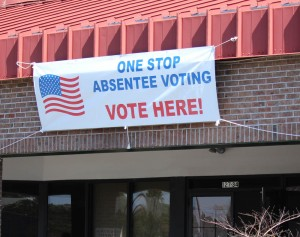 A sign outside the New Hanover County Board of Elections on the first day of one stop absentee voting for the 2016 primary election. Photo by Hannah Leyva.