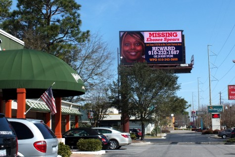The sign located near McCallister's Deli on College Road is one of six that will display a poster seeking information about Ebonee Spears, who has been missing since January. Photo by Christina Haley.