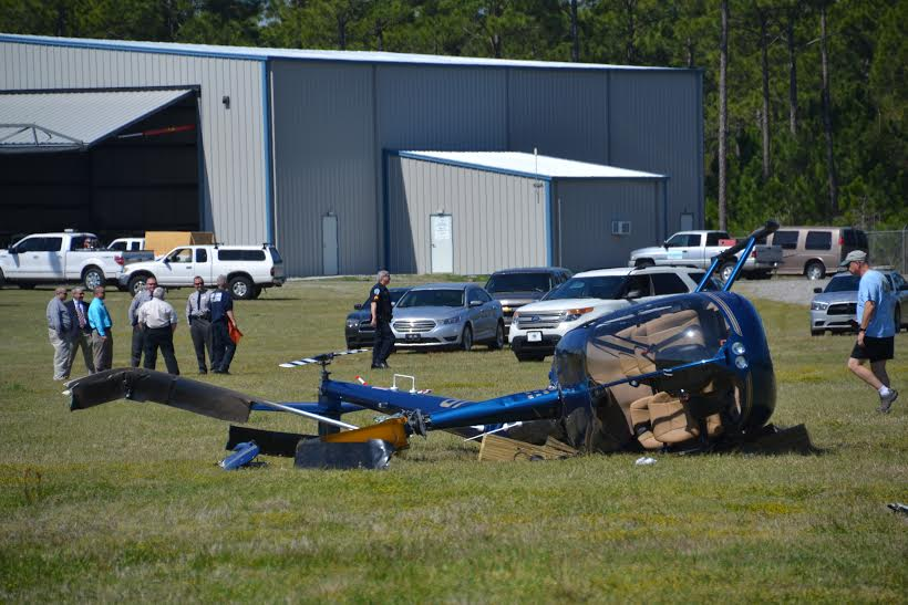 The pilot involved in the helicopter crash this morning at Cape Fear Regional Jetport in Oak Island, has been released from the hospital. Photo courtesy of the Brunswick County Sheriff's Office.