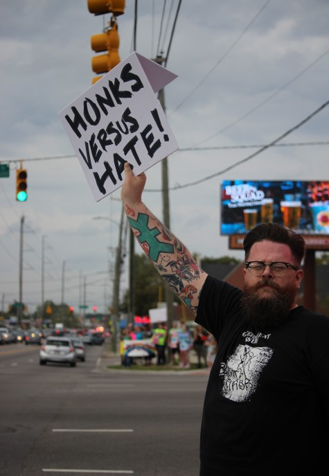 Calling on drivers to show support with their horns, rally participants received mostly honks and just a few hurtful remarks.