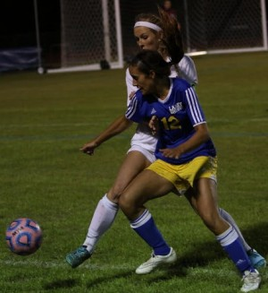Baley Edwards, front and Rebekah Fry battle for possession earlier this spring.
