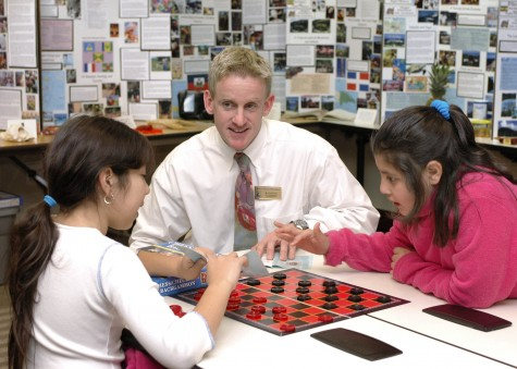 Devon Fort, a field experience coordinator with the Watson College of Education, chats with Bradley Creek Elementary School students as part of a coordinated visit from teachers in training. Watson and UNCW are calling local residents to celebrate the profession on Teacher Appreciation Day by sharing memories of their favorite teachers via Twitter. Photo by Jamie Moncrief.