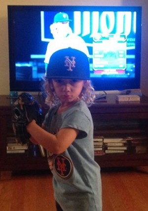Ashtin Gerberg stands in front of the TV mimicking his favorite pitcher. Photos courtesy- Aaron Gerberg.