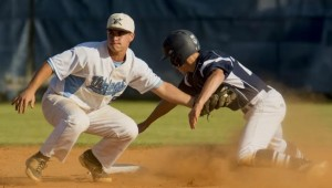 Brad Pennington tags out a runner during Saturdays victory. Photo courtesy- Mike Gans.
