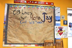 A giant poster and card were set up on a wall in the waiting area of Flaming Amy's Burrito Barn in Carolina Beach last week. Photo by Hannah Leyva.
