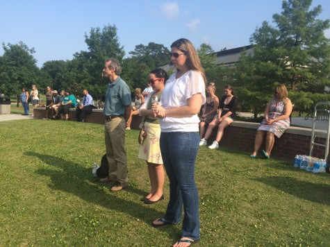 Many in attendance held lit candles during a time of silent reflection that lasted 49 seconds--one second for each life lost in the Orlando shootings.