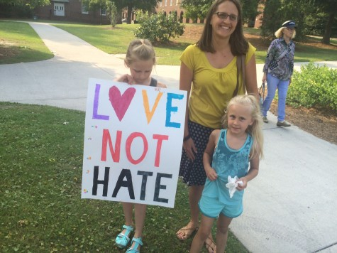 Bearing a clear message, Samantha Boomershine attends the vigil with her mother, UNCW professor Dr. Amanda Boomershine, and sister, Sofia.