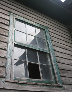 A wooden window, though slightly damaged, remains in tact on a local condemned home. HWF hopes to save wooden windows by raising awareness of their aestheic and energy-saving value when restored and reinstalled properly.
