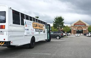 A bus parked at Harris Teeter in Mayfair Town Center will be filled with donated school supplies. Photo by Hannah Leyva.
