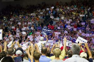 Donald Trump supporters cheer and hold signs at a rally at UNCW's Trask Coliseum on August 9, 2016. Photo by Hannah Leyva.