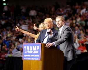 Donald Trump surrounded by his daughter-in-law-, Lara Trump, and son Eric Trump at a rally in Fayetteville in March. Photo by Gage Skidmore for donaldjtrump.com.