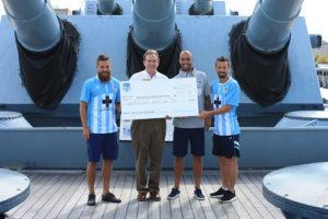 The Wilmington Hammerheads present a check to the Battleship North Carolina. Courtesy photo.