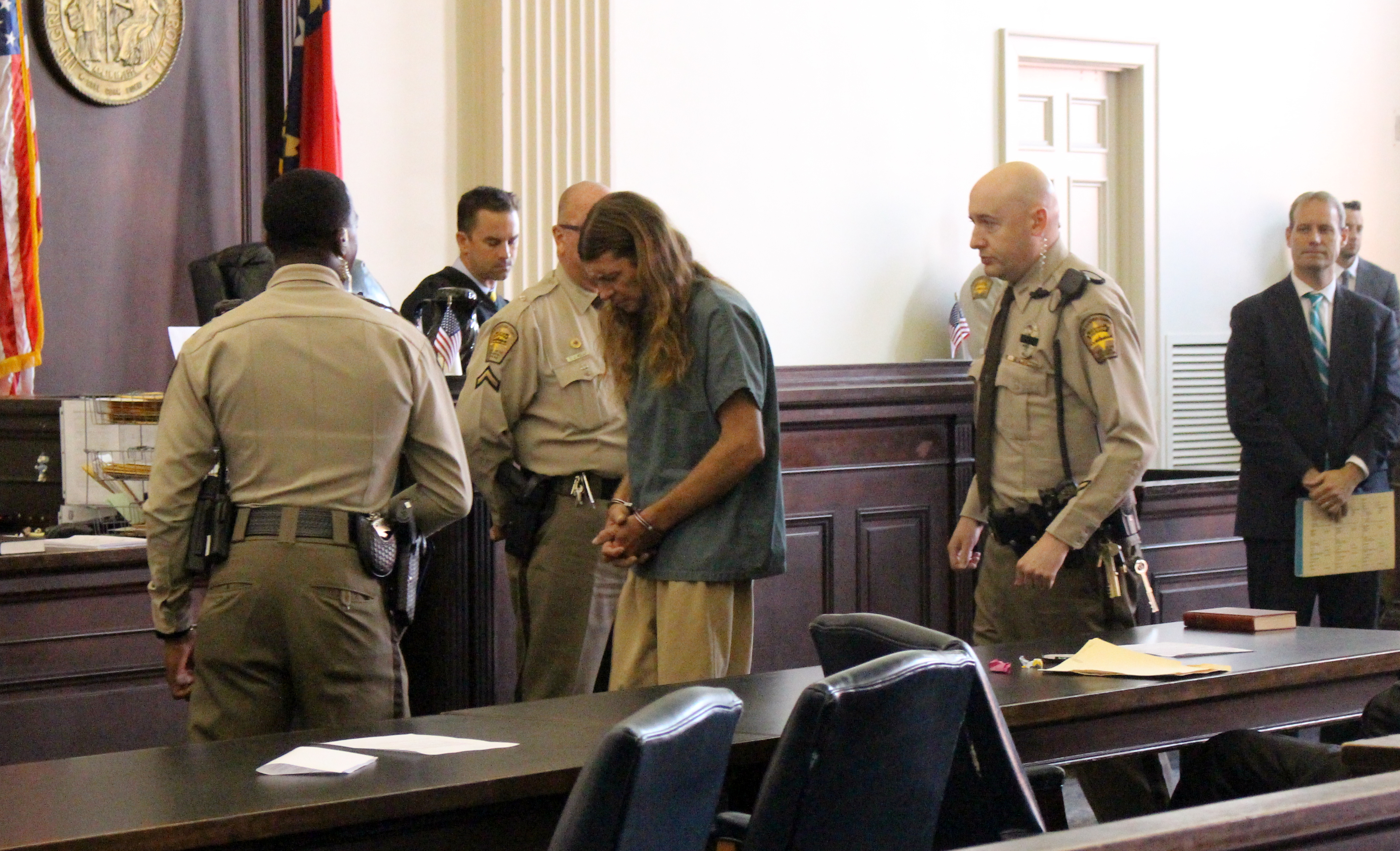 Douglas Edwards (center) appeared in district court Friday morning to face charges in a kidnapping and sexual assault of girl. (Photo by Christina Haley)