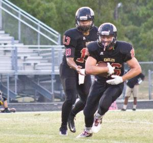 Ashley quarterback Jacob Reed (13) and running back Bradley Plyler. Photo by Hannah Leyva.