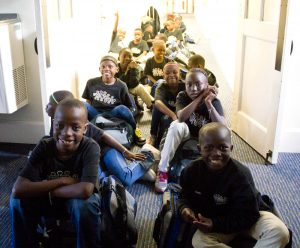 Members of the African Children's Choir 46 wait to meet their Wilmington host families. Photo by Hannah Leyva.