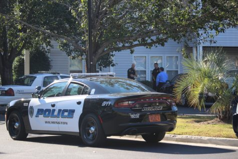 Police outside the scene of an apartment where a woman in her 20s was found dead. (Photo by Christina Haley)