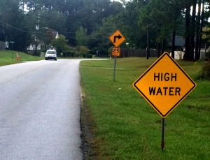 High water sign posted in a northern New Hanover County neighborhood.