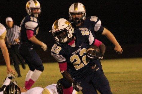 Jc Smith continues to anchor a strong run game for North Brunswick. Photo courtesy- Cape Fear Photography.