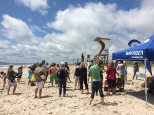 Chapter President Ethan Crouch at Hands Across the Sand event. (Courtesy: Cape Fear Surfrider Chapter)