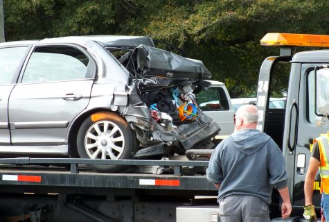 The victims' vehicle was pulled away from the scene hours after a pick-up struck the family from behind. Photo by Christina Haley.