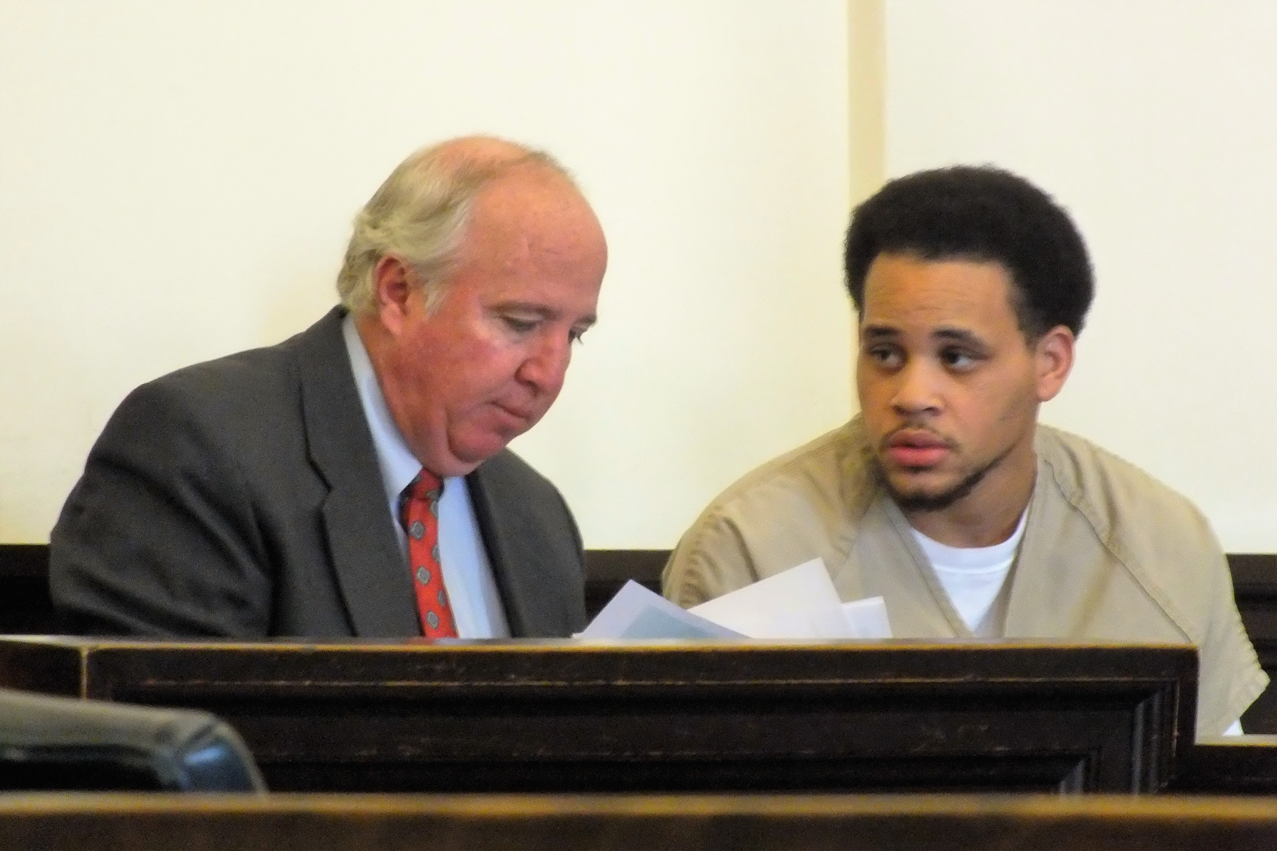 Damian Maurice Gore speaking with attorney Fred Owens ahead of his first-appearance in New Hanover County District Court on a first-degree murder charge. Photo by Christina Haley.