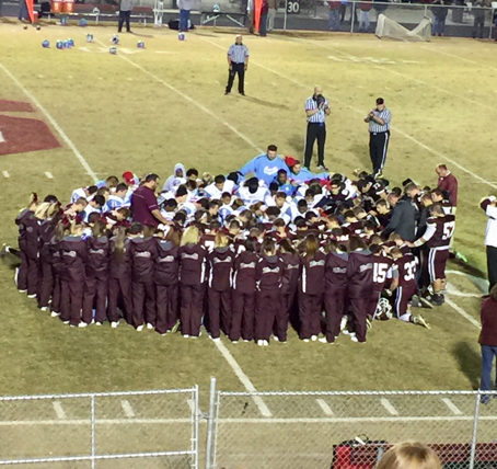 The two teams came together in a moment of prayer for the injured player. Photo courtesy- North Carolina High School Athletic Association