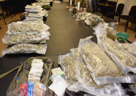 Detectives seized a large quantity of marijuana, cash, and drug paraphernalia in a marijuana trafficking investigation. (Photo courtesy of the sheriff's office.)
