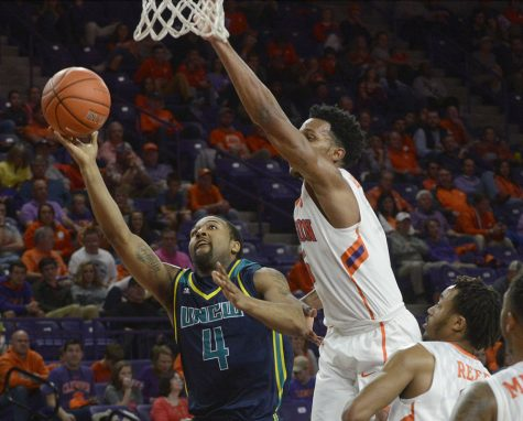 Jordon Talley drives the lane in Wednesday's match up at Clemson. Photo courtesy- UNCW Sports.