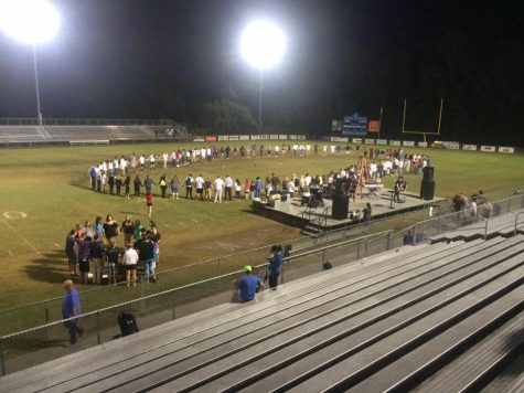 A group of students meet on the 50 yard line at Laney High School.