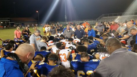 The Laney and Wallace-Rose Hill football teams met for a moment of prayer after their game this fall.