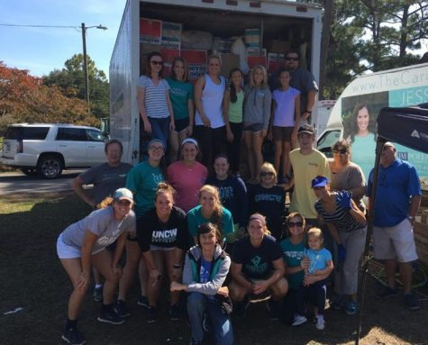 UNCW softball players logged over 1,500 hours of community service this fall. Photo courtesy- UNCW sports