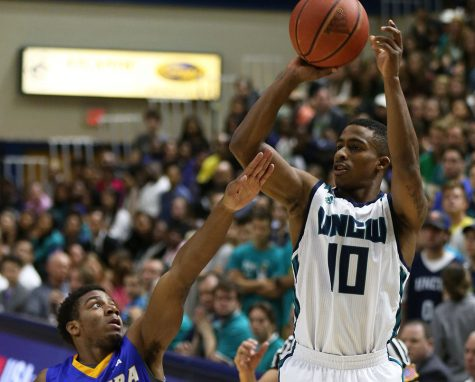 Denzel Ingram has guided UNCW at the point all season. Photo courtesy- UNCW sports