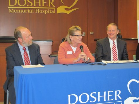 Population Health Improvement Partners Senior Director Donna Albertone (center) announced a $450,000 grant from The Duke Endowment for Dosher Memorial Hospital on Tuesday. Joining Albertone (from left) are Dr. Scott Starks, Dosher Hospital Board trustee, and Tom Siemers hospital president and CEO.