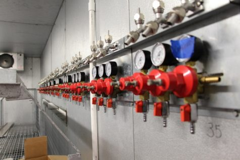 The brewery's tap cooler, located directly behind the bar. has 40 taps and short lines that allow easy cleaning.