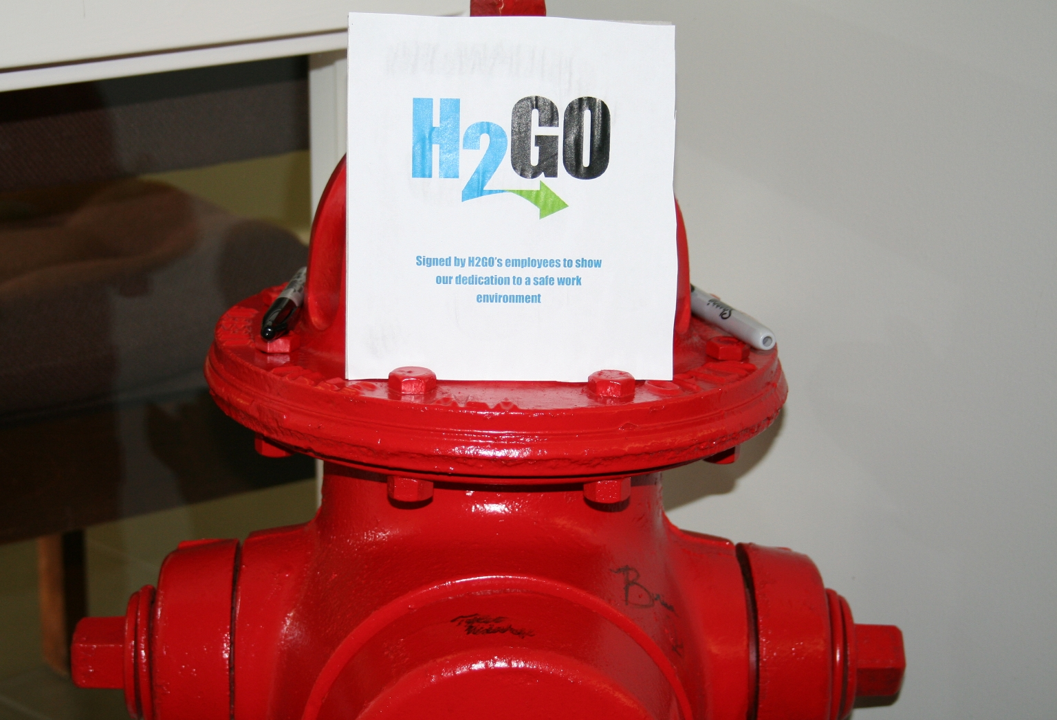 A fire hydrant signed by the H2Go staff.