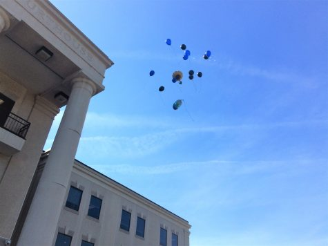 Balloons were released outside the courthouse on Monday, in memory of Caleb. Photo by Christina Haley.