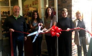 At the ribbon cutting Ceremony for Coastal Paws are (from left) Ed Wolverton of WDI, Kathleen White (co-owner), Ruthie Halko (co-owner), Mayor Pro-Tem Margaret Haynes and Nancy Bullock (Cotton Exchange).