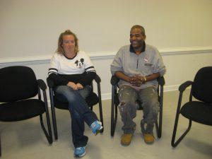 two participants smiles