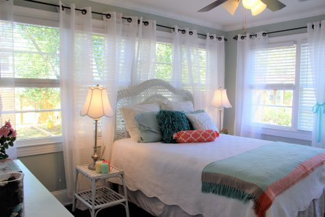 The master bedroom is lined with windows and has a full bathroom attached.