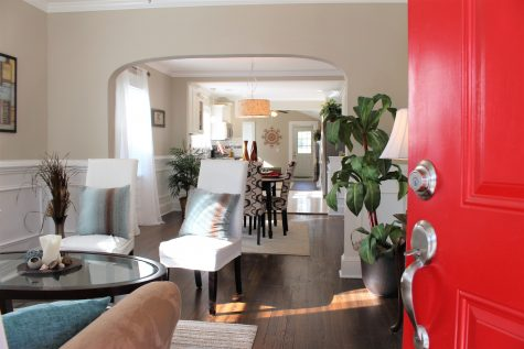 The view from the front door into the home. This style has an open floor plan throughout the formal living room, dining area, kitchen and family room.