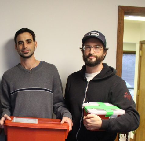 Mike Page, outreach worker, and Robert Childs, director, with recovered syringe at North Carolina Harm Reduction Coalition's Wilmington office. (Photo Benjamin Schachtman)