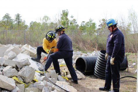 Search and Rescue members train on concrete at CFCC's North Campus. Photos by Christina Haley.