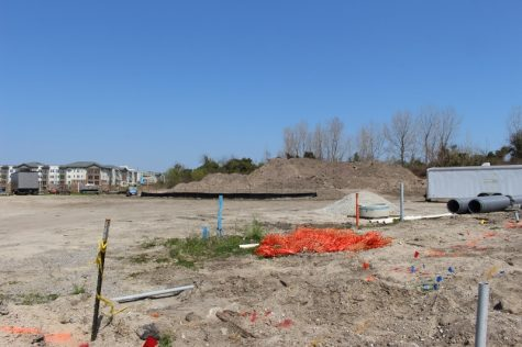 At the western end of Harnett Street in Wilmington, the future site of a proposed office complex and parking garage. In the distance, the Sawmill Point apartment complex. (Photo by Benjamin Schachtman)