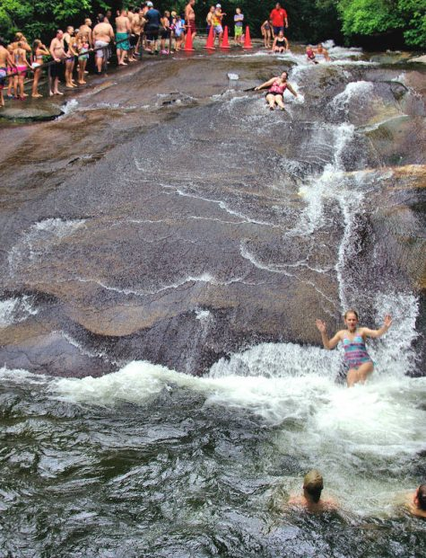 Bust your butts together --- or maybe just swim under a waterfall --- at Quarry Falls in Highland, N.C. (Port City Daily photo/COURTESY ROMANTICASHEVILLE.COM)