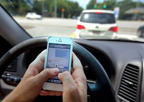 North Carolina lawmakers have proposed a law to ban hand-held communication while driving. Photo courtesy- American Safety Council.