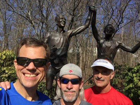 From left, Stuart Ross, Rick Poplaski and Mark Claycomb during a Saturday morning run on the marathon route at the famous Johnny Kelley statue on Commonwealth Avenue. (Port City Daily photo/COURTESY OF STUART ROSS)