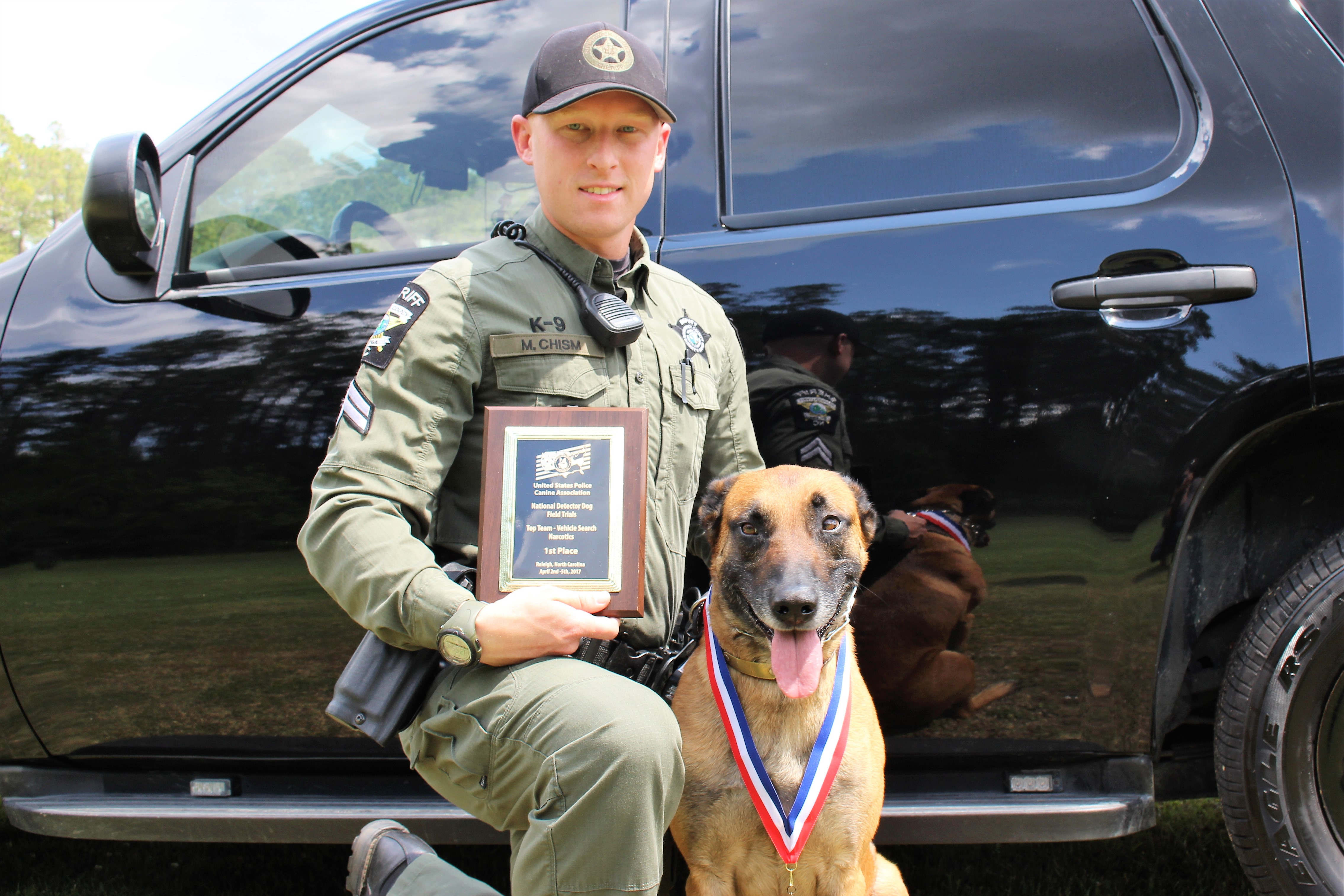 Cpl. Matt Chism and his 7-year-old Malinois, Ajk, earn a first-place award at a national K9 competition in Raleigh. (Port City Daily photo/CHRISTINA HALEY)