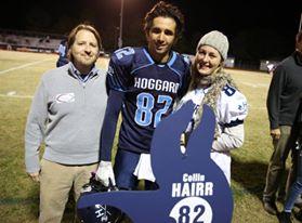 Collin Hairr and his family enjoy senior night festivities last fall. Photo courtesy- John Crouch.
